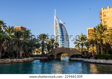 DUBAI, UAE - 10 OCTOBER 2014: View for Burj Al Arab hotel from the Madinat Jumeirah in Dubai, UAE. Burj Al Arab with 321 meters high is the most luxurious 7 star hotel and a symbol of modern Dubai.