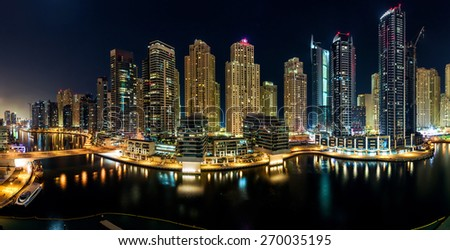 DUBAI, UAE - OCTOBER 25, 2012: View of the region of Dubai - Dubai Marina is an artificial canal city. Part of Jumeirah Beach Residence (JBR) October 25, 2012 in Dubai, UAE - stock photo