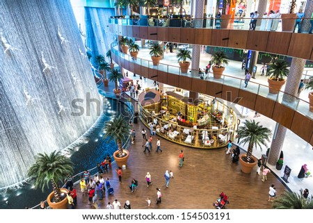 DUBAI, UAE - OCTOBER 1: Waterfall in Dubai Mall - world's largest shopping mall based on total area and sixth largest by gross leasable area, October 1, 2012 in Dubai, United Arab Emirates. - stock photo
