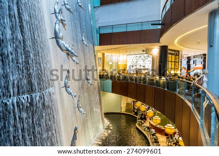 DUBAI, UAE - OCTOBER 1: Waterfall in Dubai Mall - world's largest shopping mall based on total area and sixth largest by gross leasable area, October 1, 2013  in Dubai, United Arab Emirates. - stock photo