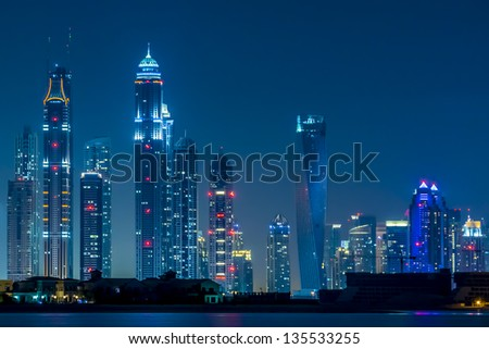 DUBAI, UAE - SEP 29: Night view of Dubai Marina from hotel Kempinski (Palm Jumeirah), on September 29, 2012 in Dubai, UAE. Dubai Marina - artificial canal city, carved along Persian Gulf shoreline. - stock photo
