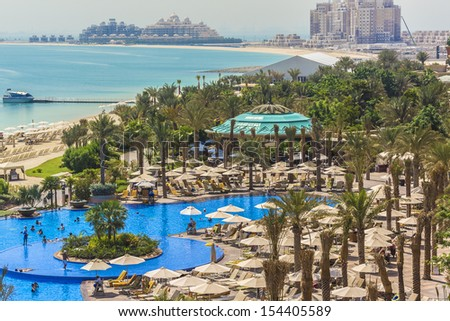 DUBAI, UAE - SEP 30: 5 stars Hotel Atlantis (1,539 spacious guest rooms including 166 suites) on man-made island of Palm Jumeirah at September 30, 2012 in Dubai, United Arab Emirates. Pool and sea.
