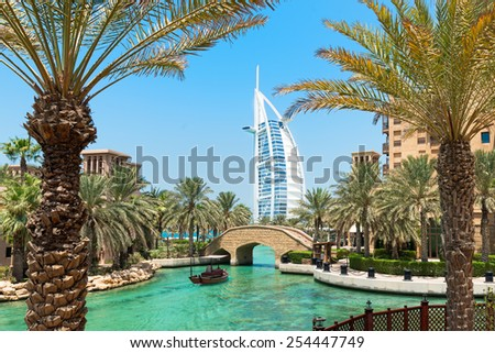 "DUBAI, UAE - SEPTEMBER 1, 2014:A general view of the world's first seven stars luxury hotel Burj Al Arab ""Tower of the Arabs"", Madinat Jumeirah in Dubai  with palms tree  - stock photo"