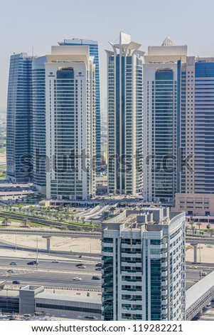DUBAI, UAE - SEPTEMBER 30: Al Seef Towers - 3 residential buildings in Jumeirah Lake Towers, on September 30, 2012 in Dubai, UAE. On November 18th 2012 a fire broke out at Tamweel Tower (on the left). - stock photo