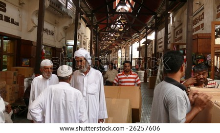 DUBAI, UAE - SEPTEMBER 29: Arabian merchants carry out business deal at the traditional Spice Souk on September 29, 2008 in Dubai, UAE. - stock photo