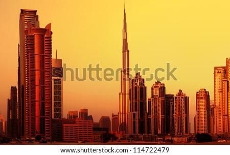 DUBAI, UAE - SEPTEMBER 23: Burj Khalifa, world's tallest tower at 828m, located at Downtown, Burj Khalifa at sunset September 23, 2012 in Dubai, United Arab Emirates - stock photo