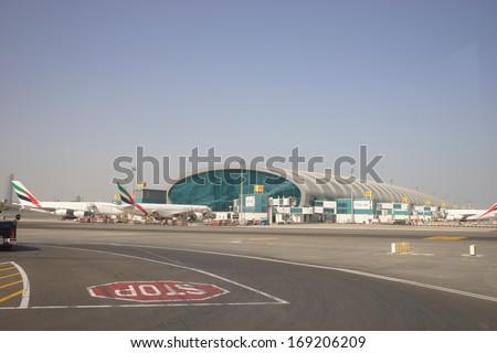 DUBAI, UAE - SEPTEMBER 27: Dubai International Airport on September 27, 2013 in Dubai, UAE. Emirates handles major part of passenger traffic and aircraft movements at the airport. - stock photo