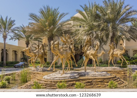 DUBAI, UAE - SEPTEMBER 30: Huge gold camels decorated entrance in 5 star hotel One&Only Royal Mirage (451 rooms, 65 acres of lush green lawns, 1 km beachfront), at September 30, 2012 in Dubai, UAE. - stock photo