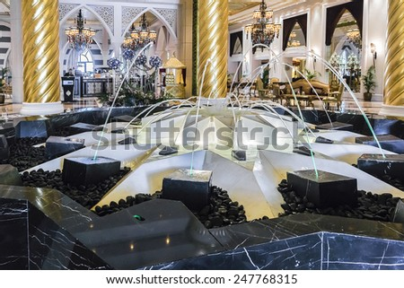 DUBAI, UAE - SEPTEMBER 29, 2012: Interior of Jumeirah Zabeel Saray - luxurious resort (405 rooms) on iconic Palm Jumeirah in Dubai. Lavish interior of resort is inspired by palaces of Ottoman period. - stock photo