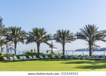 DUBAI, UAE - SEPTEMBER 29: Kempinski Hotel and Residences (129 luxury suites, penthouses and villas) on man-made island of Palm Jumeirah at September 29, 2012 in Dubai, United Arab Emirates. Pool.