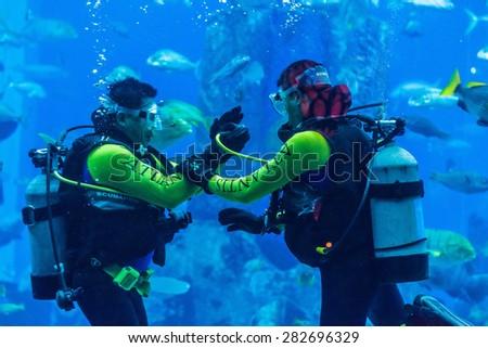 DUBAI, UAE - SEPTEMBER 30: Large aquarium in Hotel Atlantis (1,539 spacious guest rooms including 166 suites) on man-made island of Palm Jumeirah at September 30, 2012 in Dubai, United Arab Emirates. - stock photo