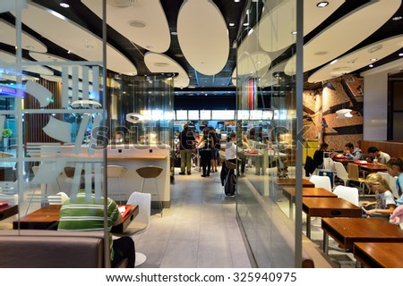 DUBAI, UAE - SEPTEMBER 08, 2015: McDonald's restaurant in Dubai Airport. There are a lot of restaurants, bars, cafes and shops in Dubai International Airport. Almost all of them are open 24 hours.