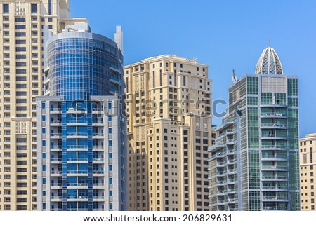DUBAI, UAE - SEPTEMBER 30, 2012: Modern skyscrapers in Dubai (emirate and city). Dubai now boasts more completed skyscrapers higher than 0,8 - 0,25 km than any other city. United Arab Emirates.