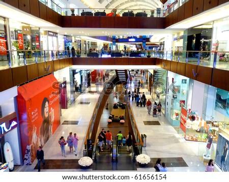 DUBAI, UAE -  SEPTEMBER 06: Shoppers at Dubai Mall September 06, 2010 in Dubai, United Arab Emirates. Dubai Mall is one of the largest mall in the world. - stock photo