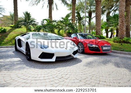 DUBAI, UAE - SEPTEMBER 11: The Atlantis the Palm hotel and luxury sport cars. It is located on man-made island Palm Jumeirah on September 11, 2013 in Dubai, United Arab Emirates - stock photo
