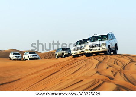 DUBAI, UAE - SEPTEMBER 12: The Dubai desert trip in off-road car is major tourists attraction in Dubai on September 12, 2013 in Dubai, UAE