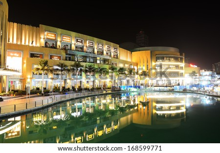 DUBAI, UAE - SEPTEMBER 9: The Dubai Mall is the world's largest shopping mall.  It is located in Burj Khalifa complex and has 1200 shops inside on September 9, 2013 in Dubai, UAE - stock photo