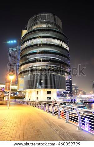 DUBAI, UAE - SEPTEMBER 11: The night illumination of Dubai Marina on September 11, 2013 in Dubai, UAE. It is an artificial canal city, built along a two mile (3 km) stretch of Persian Gulf shoreline.