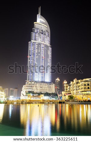 DUBAI, UAE - SEPTEMBER 10: The Night view on Address hotel, Dubai Mall and man-made lake on September 10, 2013, Dubai, UAE. Hotels in Dubai attracted over 11 million guests in 2013. - stock photo