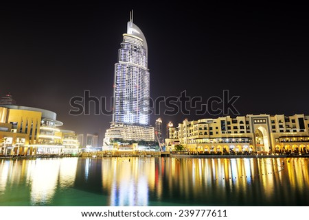 DUBAI, UAE - SEPTEMBER 10: The Night view on Dubai Mall. It is the world's largest shopping mall.  It is located in Burj Khalifa complex and has 1200 shops inside on September 10, 2013, Dubai, UAE. - stock photo