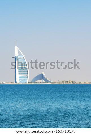 "DUBAI, UAE - SEPTEMBER 9: The view on world's first seven stars luxury hotel Burj Al Arab ""Tower of the Arabs"", also known as ""Arab Sail"" on September 9, 2013 in Dubai, United Arab Emirates - stock photo"