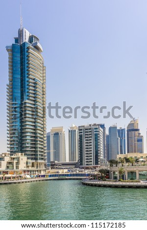 DUBAI, UAE - SEPTEMBER 29: View at modern skyscrapers in Dubai Marina on September 29, 2012 in Dubai, UAE. Dubai Marina - artificial canal city, carved along a 3 km stretch of Persian Gulf shoreline. - stock photo