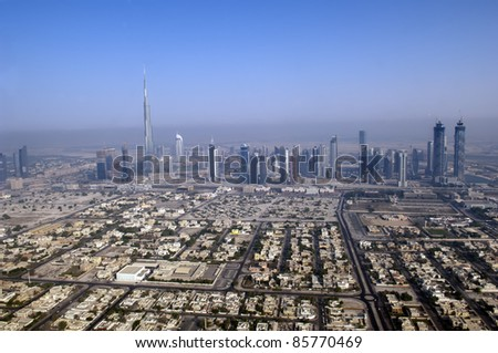 DUBAI, UAE - SEPTEMBER 26: View at Sheikh Zayed Road skyscrapers in Dubai at September 26, 2011. More than 25 skyscrapers taller than 100 meters can be found there. - stock photo