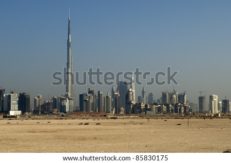 DUBAI, UAE - SEPTEMBER 23: View at Sheikh Zayed Road skyscrapers in Dubai at September 23, 2011. More than 25 skyscrapers taller than 100 meters can be found there. - stock photo