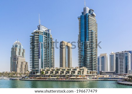 DUBAI, UAE - SEPTEMBER 29, 2012: View Dubai Marina skyscrapers and man-made island of Palm Jumeirah. Dubai Marina - artificial canal city, carved along Persian Gulf shoreline. United Arab Emirates. - stock photo