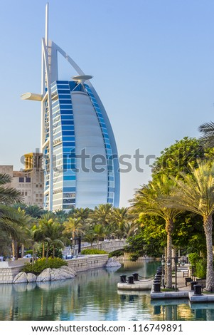DUBAI, UAE - SEPTEMBER 29: View of Burj al Arab hotel (7 star, 1999) from territory of Madinat Jumeirah hotel at September 29, 2012, Dubai, United Arab Emirates. Madinat Jumeirah - luxury 5 star hotel