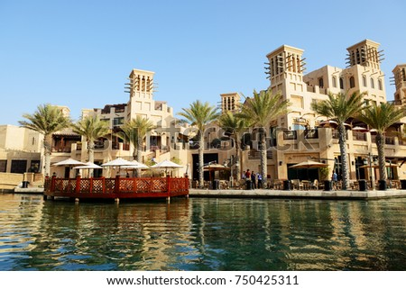 DUBAI, UAE - SEPTEMBER 9: View of the Souk Madinat Jumeirah. Madinat Jumeirah encompasses two hotels and clusters of 29 traditional Arabic houses on September 9, 2013 in Dubai, UAE