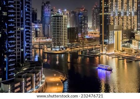 DUBAI, UAE - SEPTEMBER 29, 2012: Wonderful Night view of Dubai Marina. Marina - a district of Dubai along artificial canal, carved along a 3 km stretch of Persian Gulf shoreline. United Arab Emirates. - stock photo