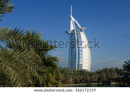 DUBAI,UAR - JAN 19: Burj Al Arab hotel on January 19, 2010 in Dubai, UAE. Burj Al Arab is a luxury 5 stars hotel built on an artificial island in front of Jumeirah beach. - stock photo