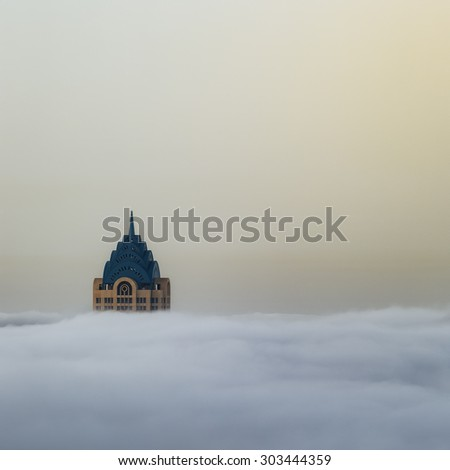 DUBAI, UNITED ARAB EMIRATES- April 4, 2015: Dubai skyline under the fog in Dubai on 4 April, 2015 in the United Arab Emirates. - stock photo