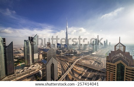 DUBAI, UNITED ARAB EMIRATES - CIRCA DECEMBER 2012 - Burj Khalifa, tallest building in the world, standing over Sheikh Zayed Road during the day.  - stock photo