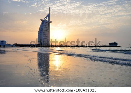 DUBAI, UNITED ARAB EMIRATES - CIRCA JANUARY 2014: The Burj Al Arab in Dubai, United Arab Emirates, at the sun set. This is one of the most expensive hotels in the world, and the first 7 stars hotel.