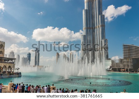 Dubai, United Arab Emirates - Dec 2, 2014 :View of the Burj Khalifa and fountains on the Burj Khalifa Lake. The tallest building in the world, at 828m. Located on Downtown Dubai, Sheikh Zayed Road. - stock photo