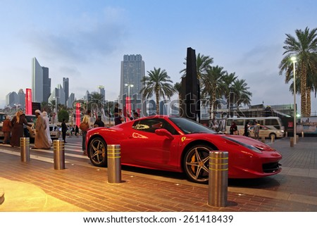 DUBAI, UNITED ARAB EMIRATES, - FEB 05, 2014: Ferrari 458 Spider parked on the street in the evening city - stock photo