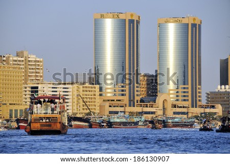 DUBAI, UNITED ARAB EMIRATES - FEBRUARY 8, 2014: A ferry carries passengers across the Dubai creek. At the background is the Deira side of the creek, February 8, 2014 Dubai, United Arab Emirates