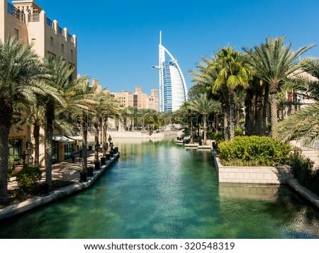 DUBAI, UNITED ARAB EMIRATES - JAN 25, 2014: Madinat Jumeirah Resort and tower of Burj al Arab Hotel in Dubai, United Arab Emirates - stock photo