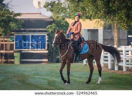 Dubai, United Arab Emirates, January  16th, 2016: horse rider in a desert