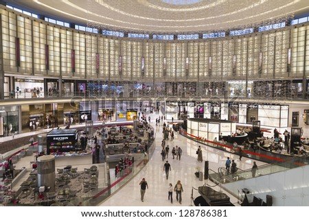 DUBAI, UNITED ARAB EMIRATES - JANUARY 8: The Dubai Mall. The greatest Mall in Dubai. Many people walking between shops and restaurants in January 8, 2013 during sales period. - stock photo