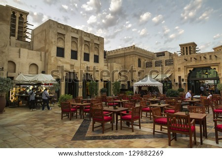 DUBAI, UNITED ARAB EMIRATES - JANUARY 9 : The Madinat Souk at Madinat Jumeirah Hotel. Some people are walking, watching shops and others are seated at the restaurant on January 9, 2013 in Dubai - stock photo