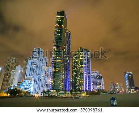 DUBAI, UNITED ARAB EMIRATES - JANUARY 29, 2016: View of modern skyscrapers in Jumeirah beach residence, JBR contains 40 towers, 35 are residential and 5 are hotels. - stock photo