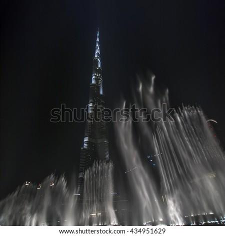 Dubai, United Arab Emirates - June 17, 2010: Burj Khalifa and illuminated fountain - stock photo