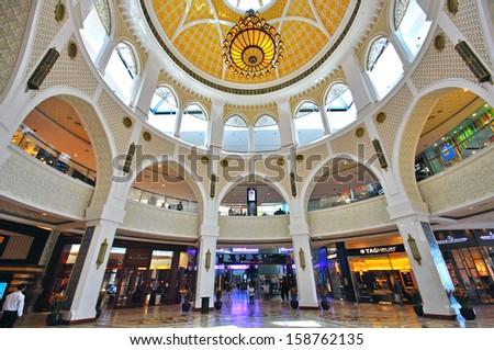 DUBAI, UNITED ARAB EMIRATES - JUNE 11: People shopping in the mall of Dubai on June 11, 2012. Dubai is a city in the United Arab Emirates, located within the emirate of the same name. - stock photo