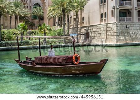 DUBAI, UNITED ARAB EMIRATES - JUNE 26, 2016: View along an Abra waterway in the Madinat Jumeirah hotel. - stock photo