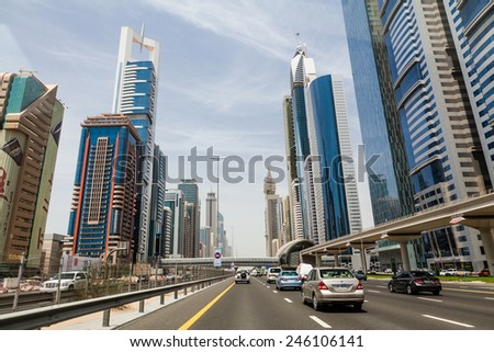 DUBAI, UNITED ARAB EMIRATES - MAY 6: Skyscrapers along Sheikh Zayed Road in Dubai on May 6, 2012. Its a skyscraper areal in Dubai that contains for example  the Emirates Office Tower&Hotel. - stock photo