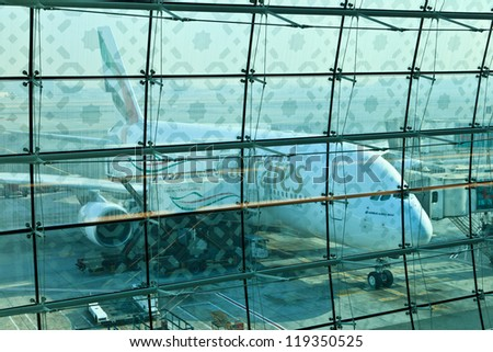 DUBAI, UNITED ARAB EMIRATES - NOVEMBER 10: Emirates Airlines Airbus A380 docked at Dubai Airport on November 10, 2012 in Dubai, UAE. Emirates was first customer to place order for the a380. - stock photo
