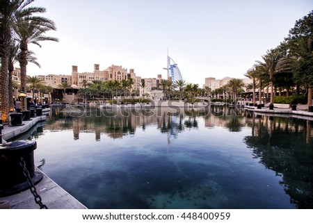 DUBAI, UNITED ARAB EMIRATES - October 19: Madinat Jumeirah with in the background the Burj Al Arab, October 19 , 2013 in Dubai. - stock photo